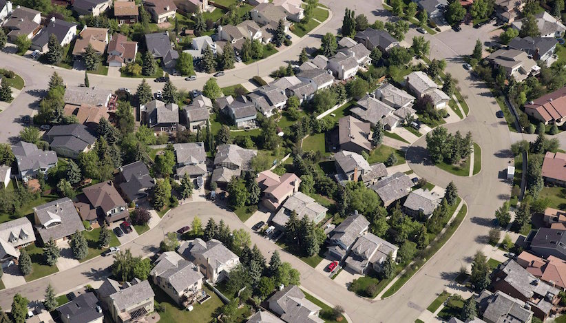 An aerial view of housing is shown in Calgary on June 22, 2013. The Canadian Real Estate Association expects average house prices in Alberta, Saskatchewan and Newfoundland and Labrador to fall next year because of the downturn in the oil industry.The association is estimating Alberta's average housing price will fall in 2016 by 2.5 per cent. THE CANADIAN PRESS/Jonathan Hayward